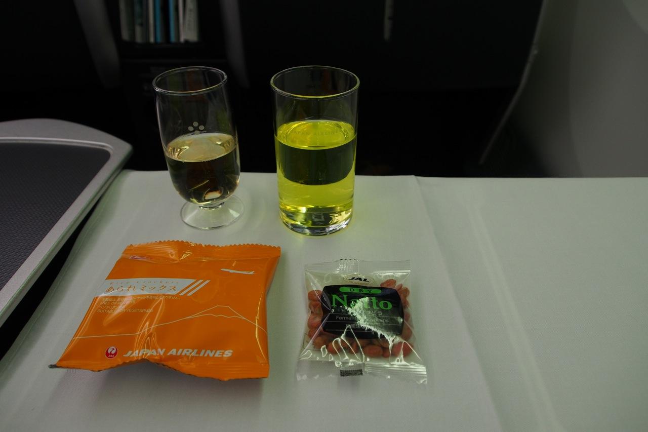 Champagne, Skytime Kiwi (JAL Kiwi-flavor drink) and snacks